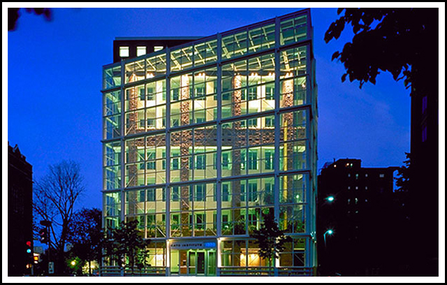 The Cato Institute building in Washington, D.C. includes an auditorium, conference facilities, library, six-story winter garden atrium, leasable office space and two levels of underground parking. The challenging site of the building - along a diagonal avenue slicing through the orthogonal city grid - was addressed with a play of intersecting squares, transparent and solid. A unique element of the building is a 10-foot high masonry parapet, incorporated on all sides of the solid cube to hide themechanical equipment on the roof.  Completely unified with the rest of the masonry cube, this parapet takes on the character of an additional level when viewed from the street. 